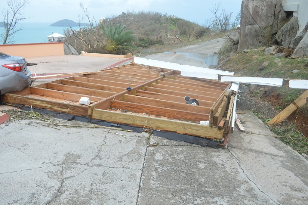 patio roof wedged under rental car after hurricane