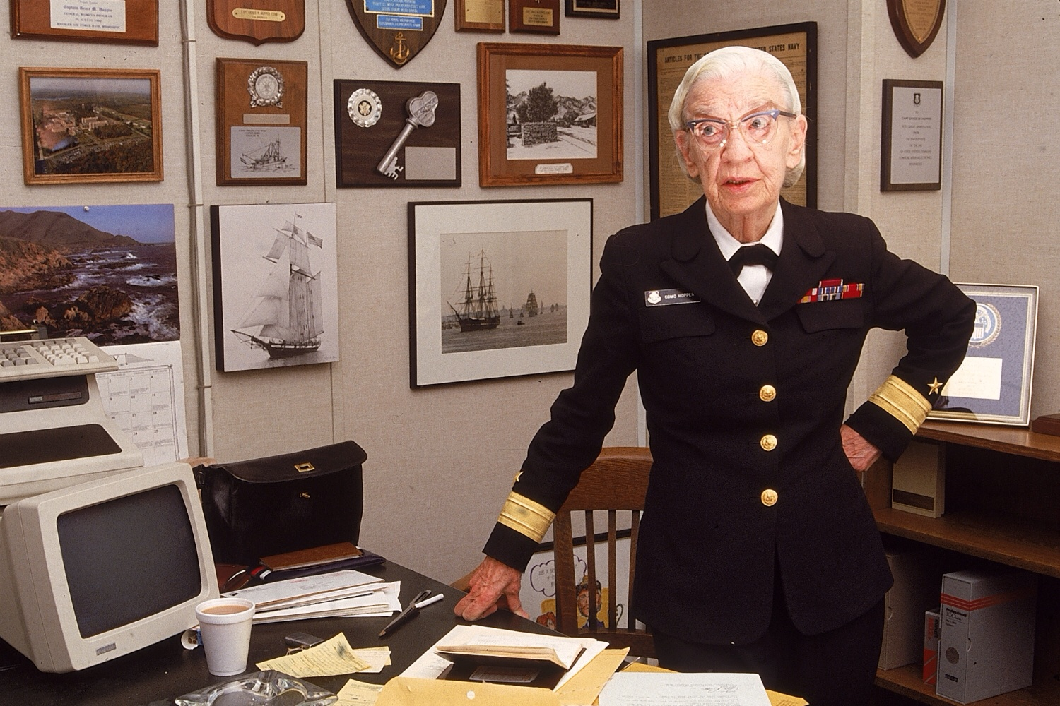 Admiral Grace Hopper in her office with a DEC VT220 Terminal on her desk