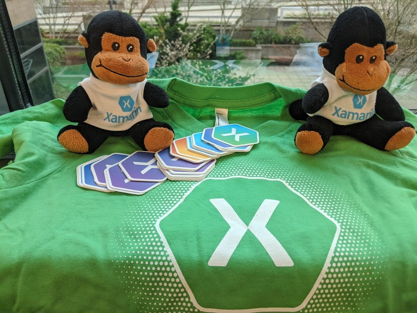 Xamarin swag including stickers, monkeys, and shirts